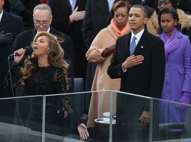 Beyonce performs the National Anthem during the pu