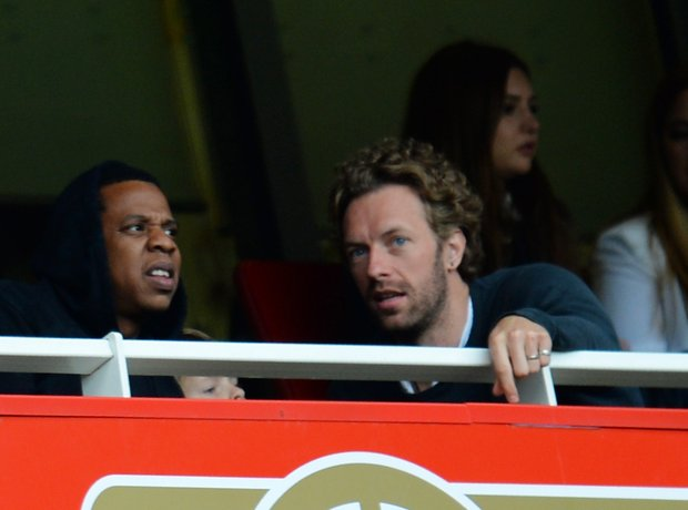 Jay-Z and Chris Marting watching football