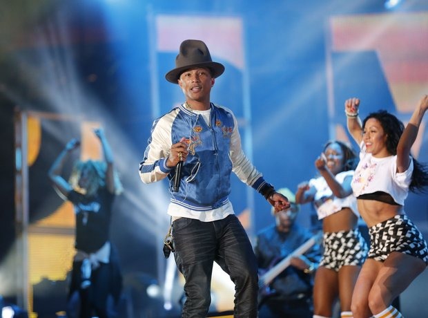 Pharell performing on stage