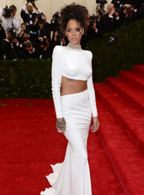 Rihanna in a white top and skirt on the red carpet