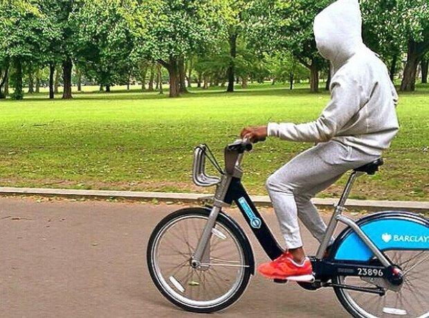 Tinie Tempah riding a boris bike