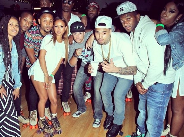 Chris Brown With Family And Friends at roller disco