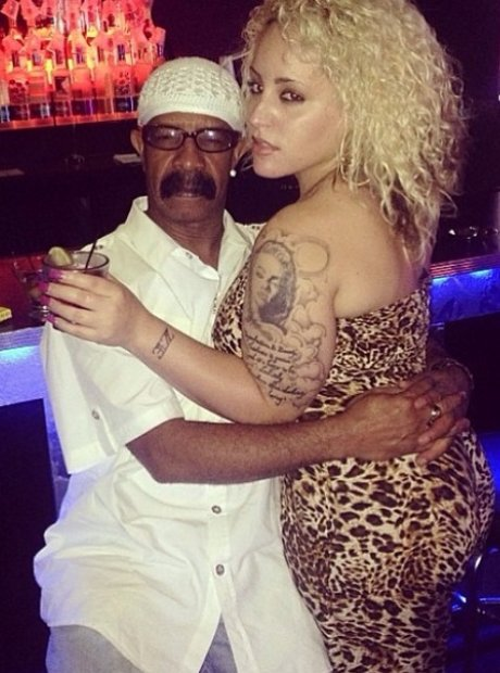 Drake's dad with woman