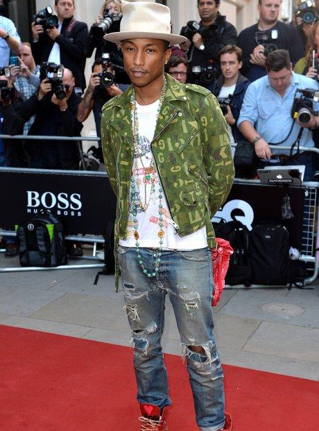 Pharrell Williams arrives at the GQ Awards 2014