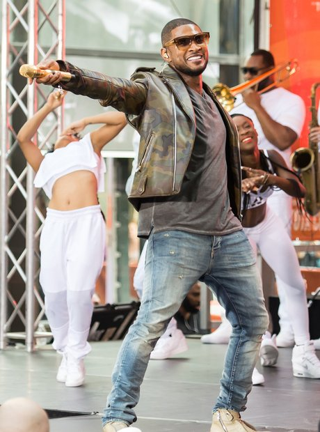 Usher performs on stage