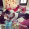 Image 3: Ne-Yo helps his children open their presents on Ch