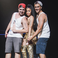 Image 5: Nicki Minaj poses with fans on stage