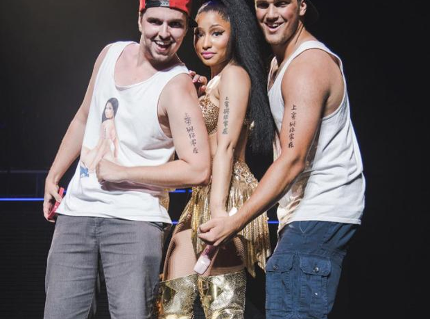 Nicki Minaj poses with fans on stage