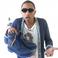 Image 5: Pharrell Williams holding trainers