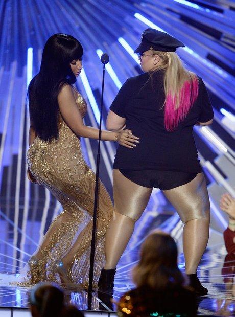 Nicki Minaj slaps Rebel Wilson's bum on stage at t