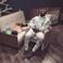 Image 10: Kanye West and North West sleeping
