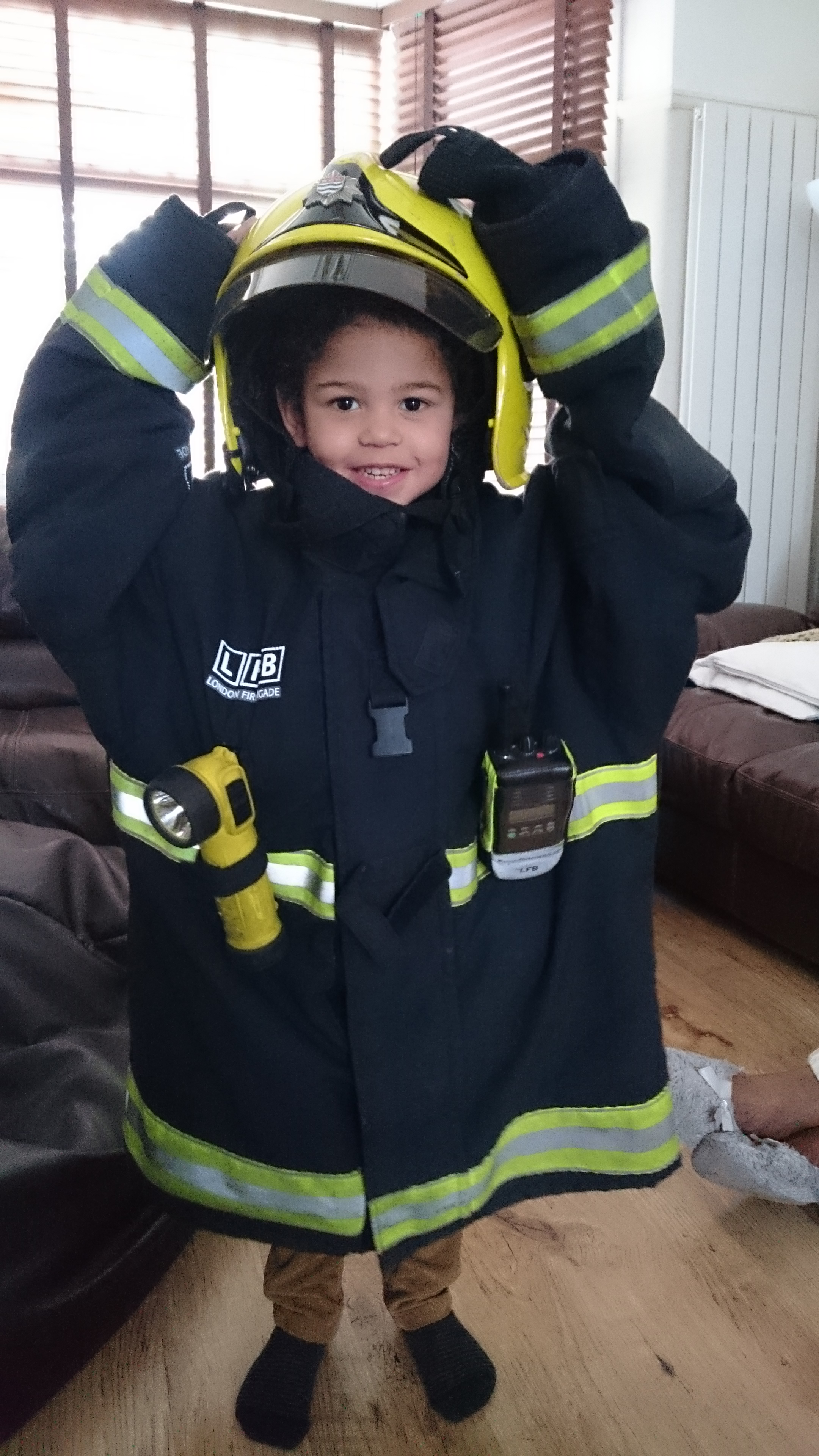 Child in fireman uniform