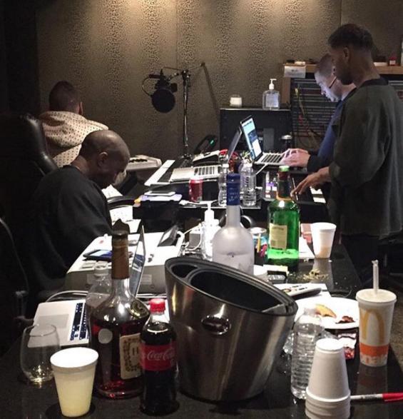 Kanye West and Kid Cudi in studio