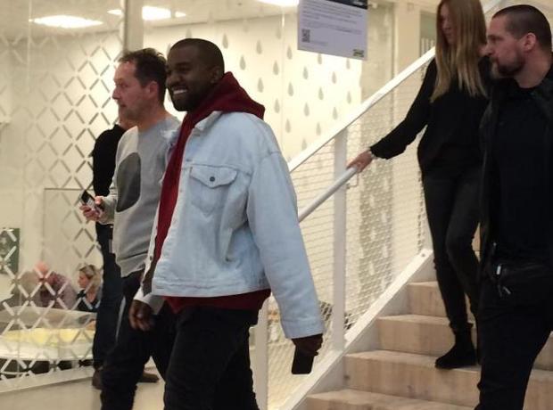 Kanye West walking down stairs in Ikea