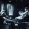 Image 5: Justin Timberlake and Pharrell sitting on chairs