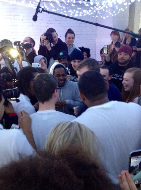 Kendrick Lamar in the middle of a crowd