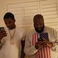 Image 6: Meek Mill and Rick Ross looking at mobile phones