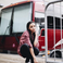 Image 8: Tinashe standing in front of tour bus