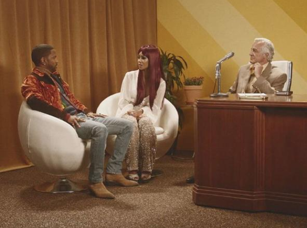 Big Sean and Jhene Aiko sat on chairs