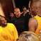 Image 1: Kobe Bryant stood with Kanye West