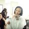 Image 5: Rihanna putting on lip stick