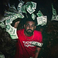 Image 9: Drake throwing money