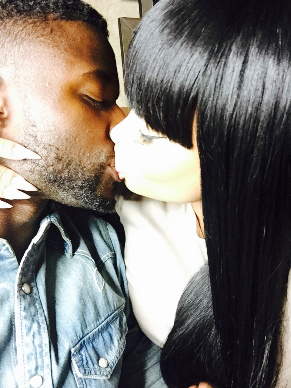 Blac Chyna and Pilot spotted kissing