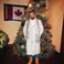 Image 3: Drake in front of a Christmas tree
