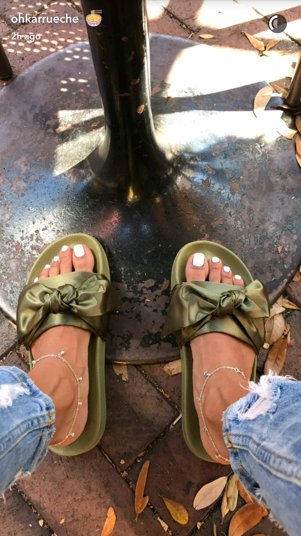 Karrueche Tran weaeing Rihanna's Puma sliders.