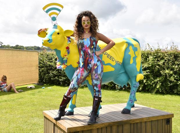 Ella Eyre wearing wellies at Glastonbury 2015