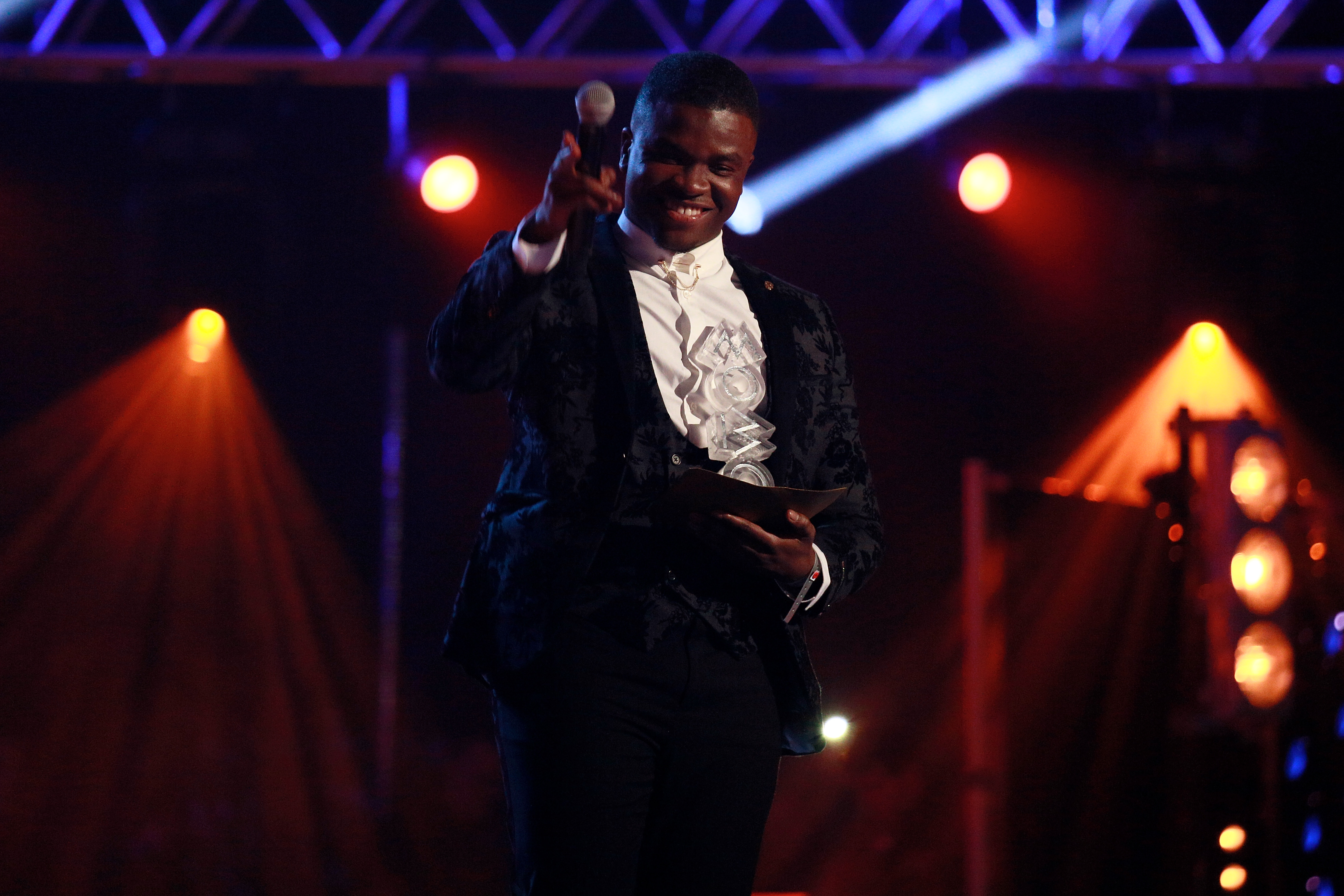 Michael Dapaah speaks on stage at the MOBO Awards