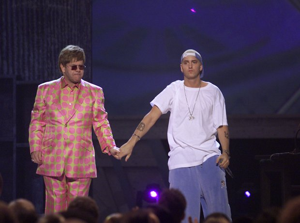Elton John and Eminem holding hands