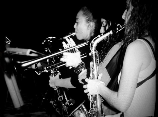 Beyonce playing a saxaphone