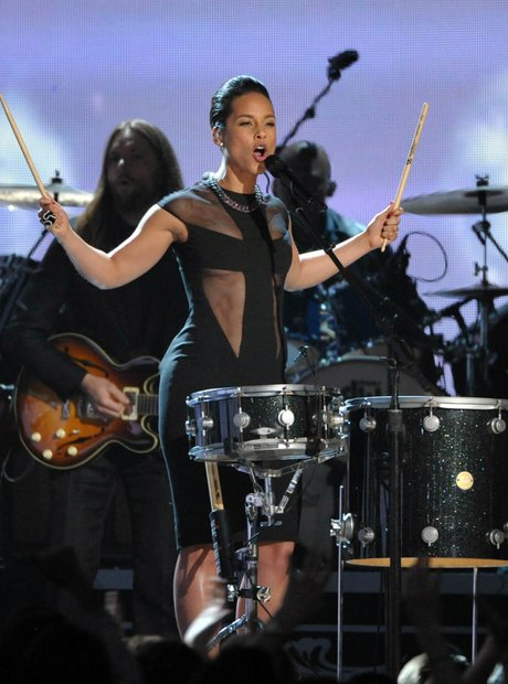 Adam Levin of Maroon 5 and Alicia Keys perform at