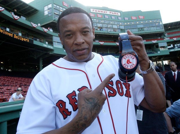 Dr Dre holding beats headphones at Red Sox game