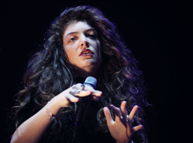 lorde performing on stage.