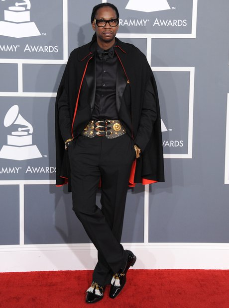 2 Chainz wearing black trousers and gold belt