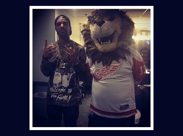 Drake and a lion mascot