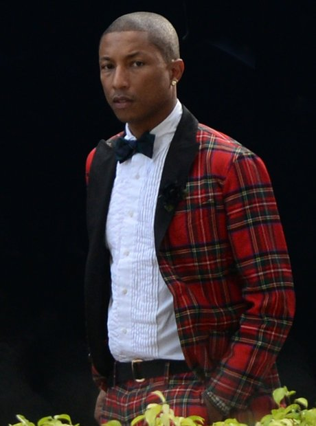 Pharrell celebrates his wedding wearing a tartan suit