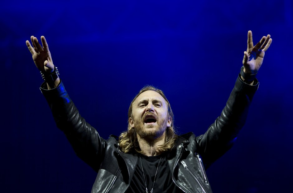 David Guetta with his hands in the air