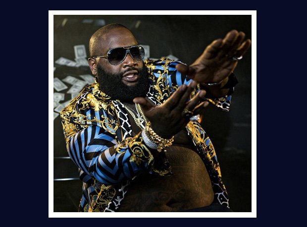 Rick Ross in gold and blue shirt