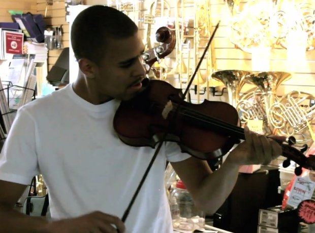 J Cole playing the violin Terry Sandford Orchestra