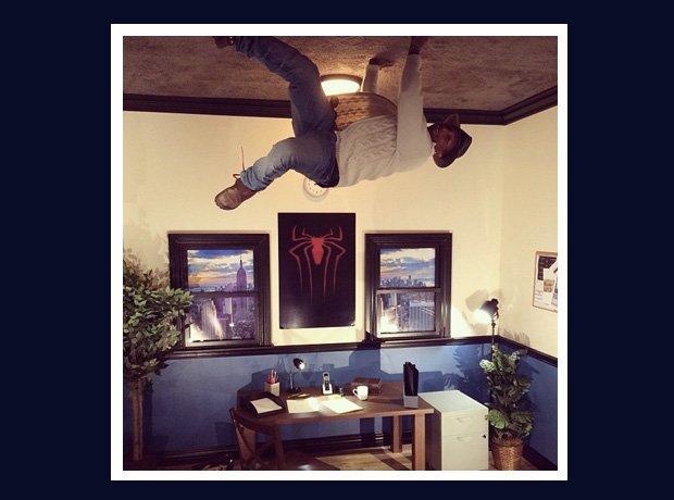 Pharrell Williams like Spider-Man on ceiling