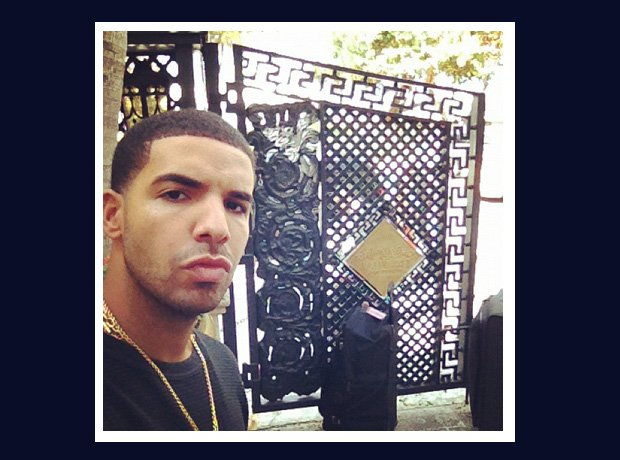 Drake in front of a gate selfie