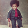 Image 9: Pharrell as a child wearing denim jacket and jeans