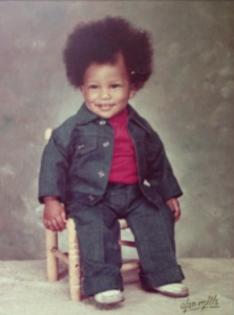 Pharrell as a child wearing denim jacket and jeans