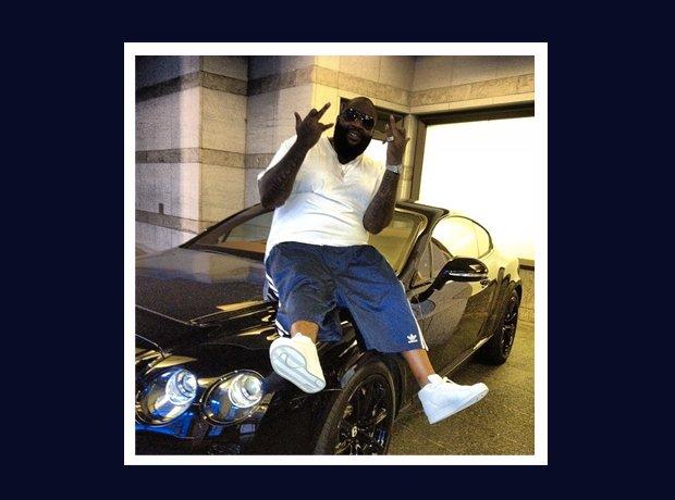 Rick Ross Instagram sitting on car