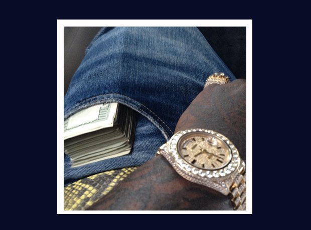 Rick Ross Instagram money and watch