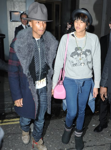 Pharrell with his girlfriend