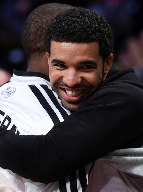 Drake hugging basketball player